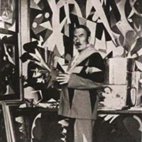 Giacomo Balla in his studio holding Futurist Flowers green, navy blue and blue